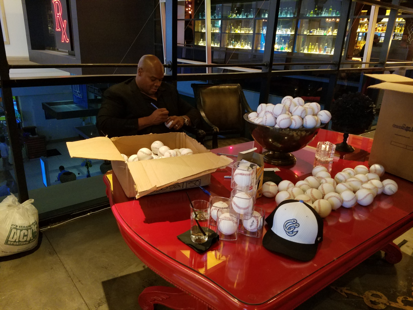 The Big Hurt, Frank Thomas, baseball Hall of Famer signing lots of swag, I sat down next to him and asked if he could sign a few things